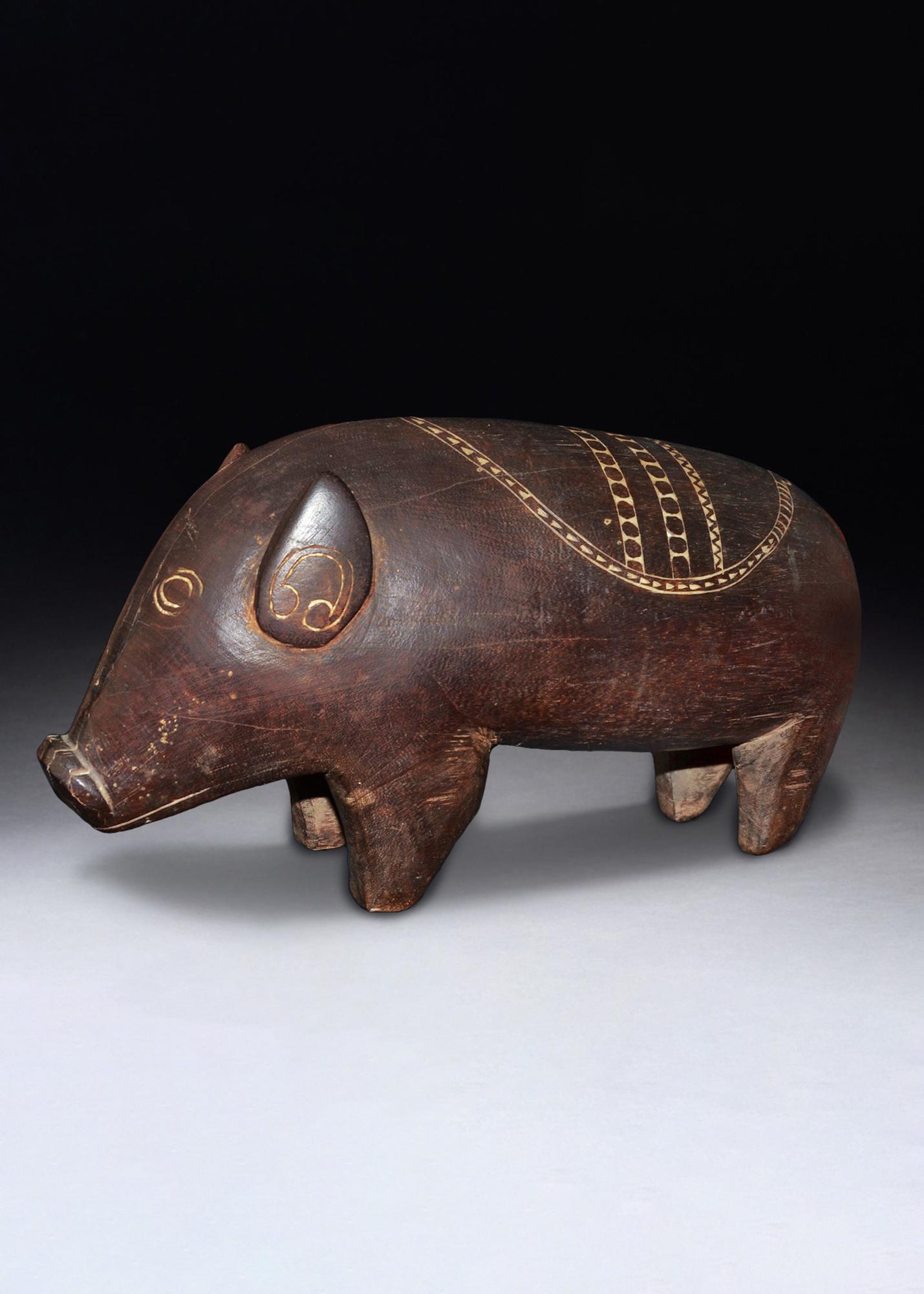 A Finely Carved large Massim Pig Figure