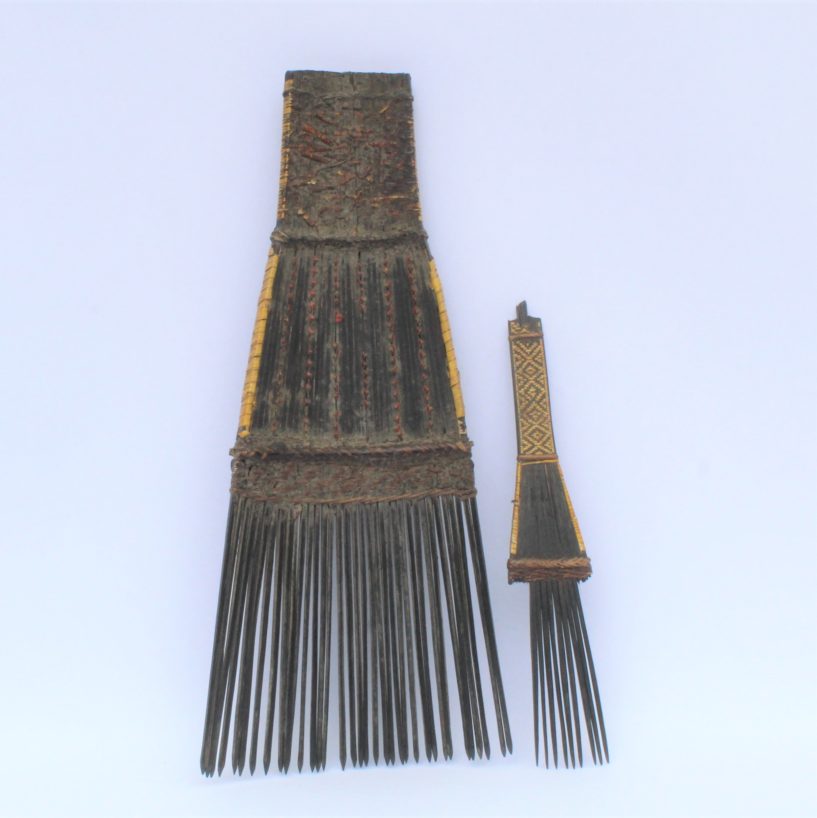 Two orchid fiber combs.