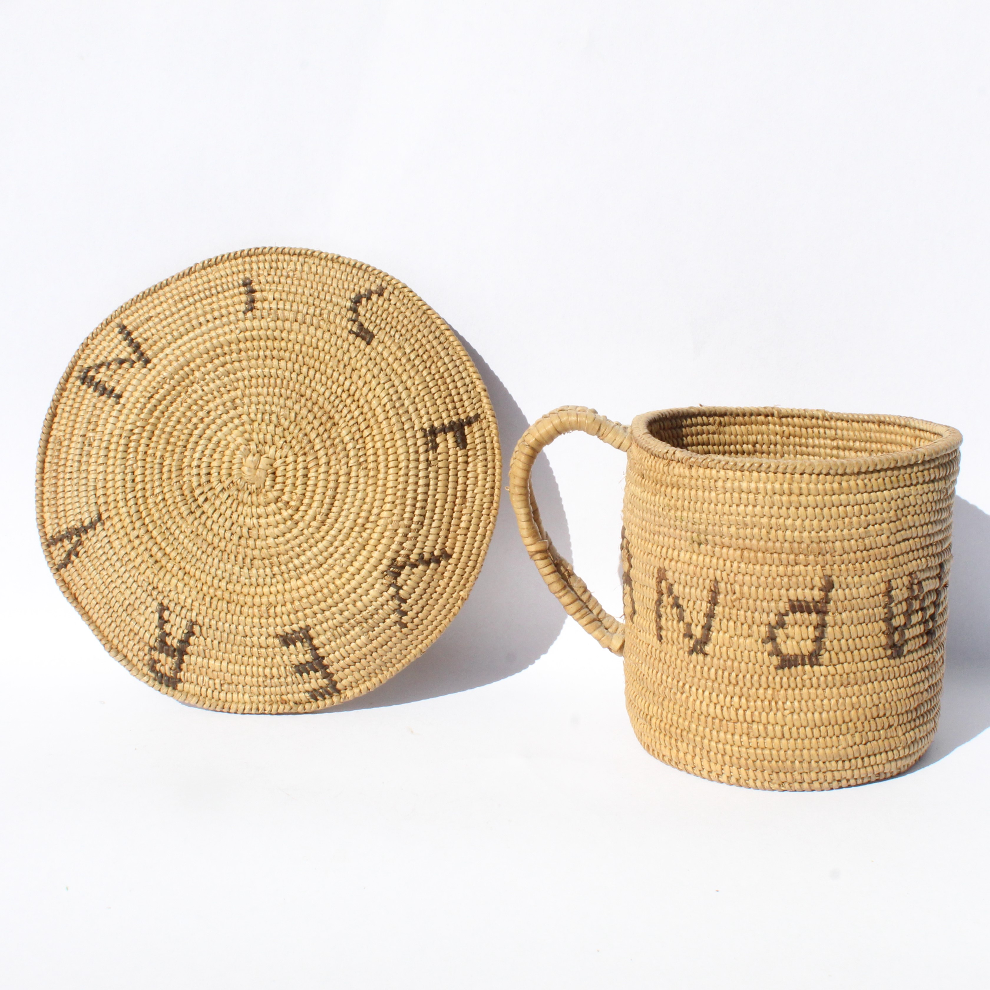 A basketry cup, three beaded Martini Henry rifle shell cases and two shell bracelets.