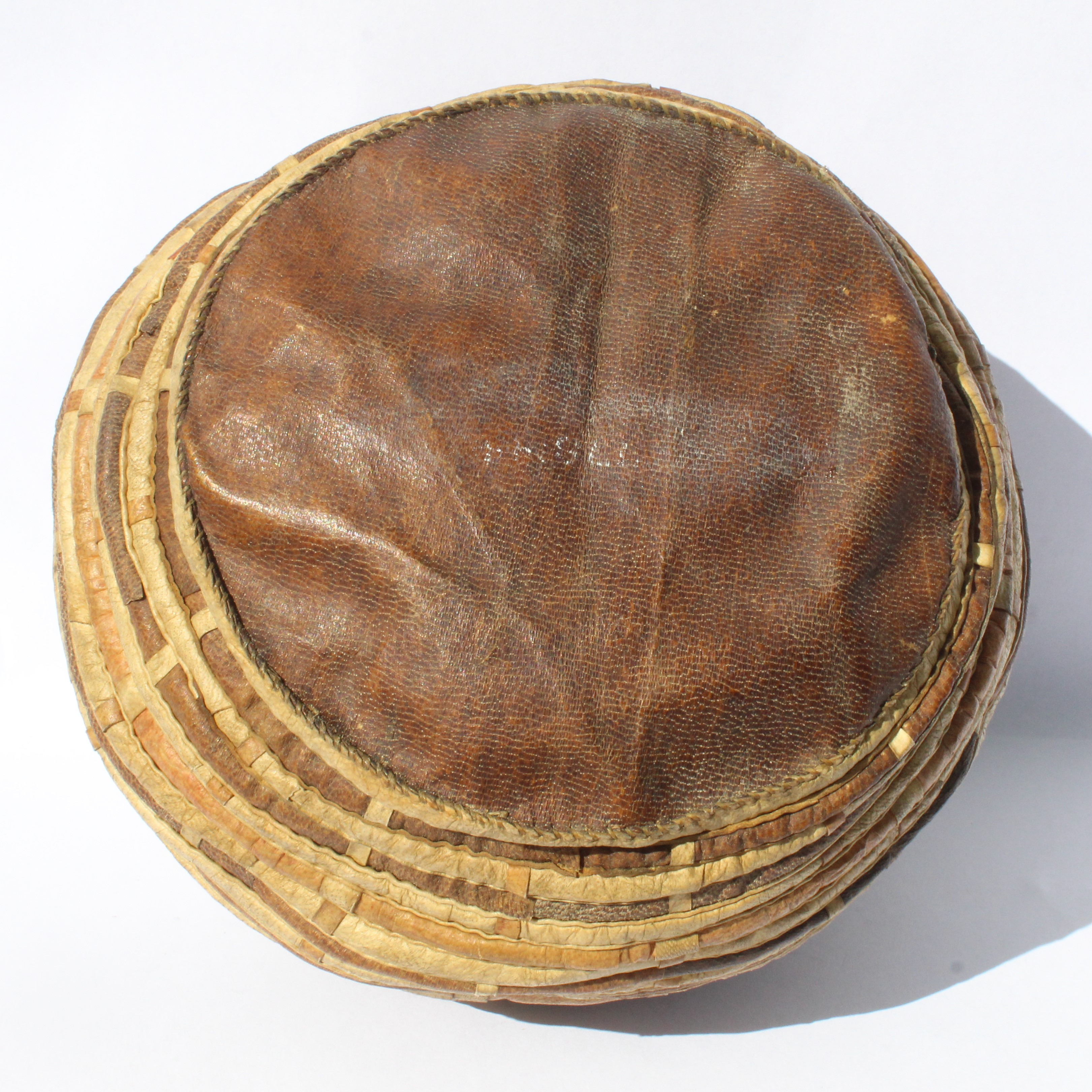A sealskin and beadwork sewing utensil container.