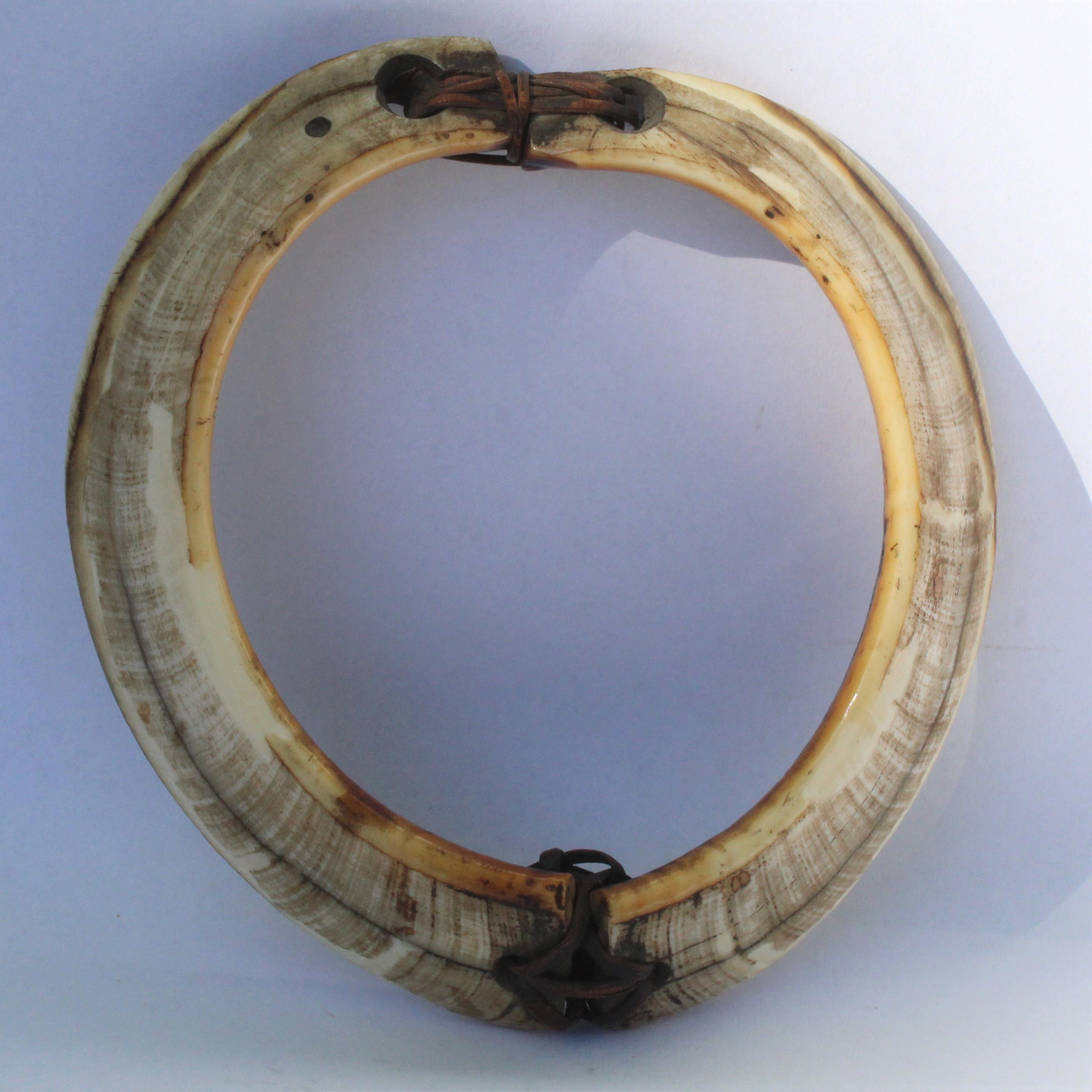 Two boar tusk bracelets. One currency.