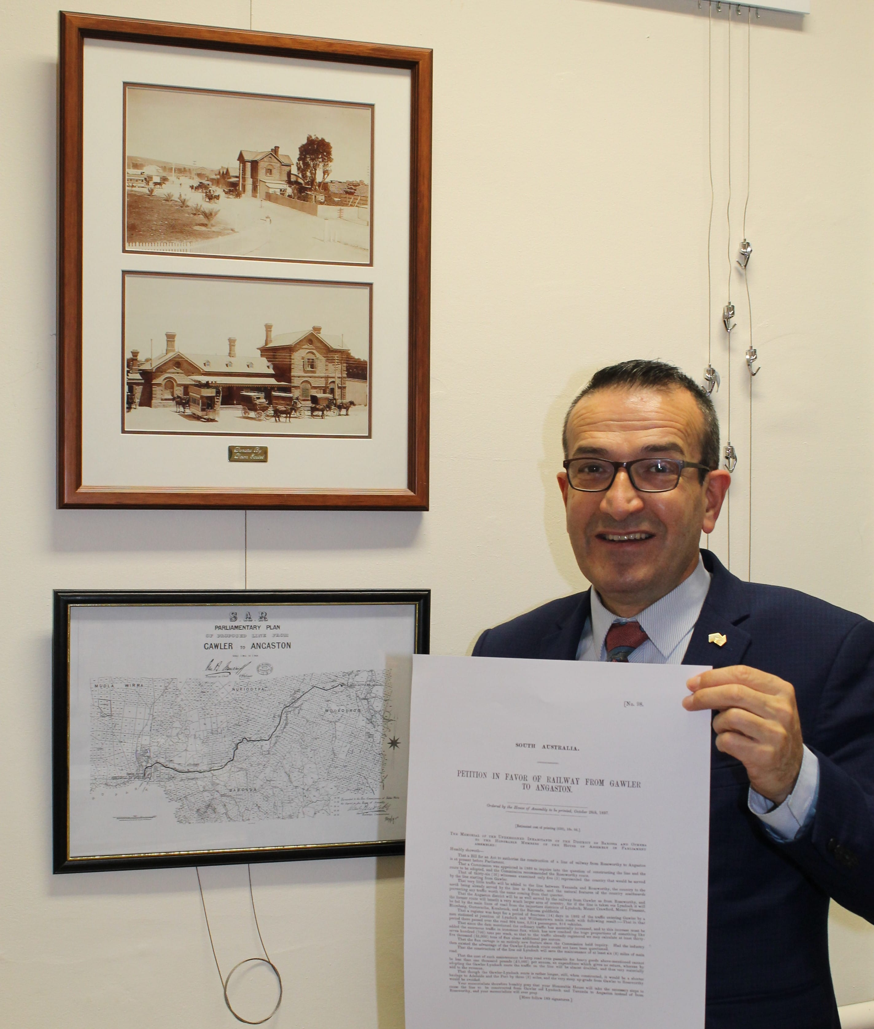 Tony Piccolo MP with some of the items in the exhibition, including a copy of one of the petitions tabled in State Parliament on 28th October 1897.