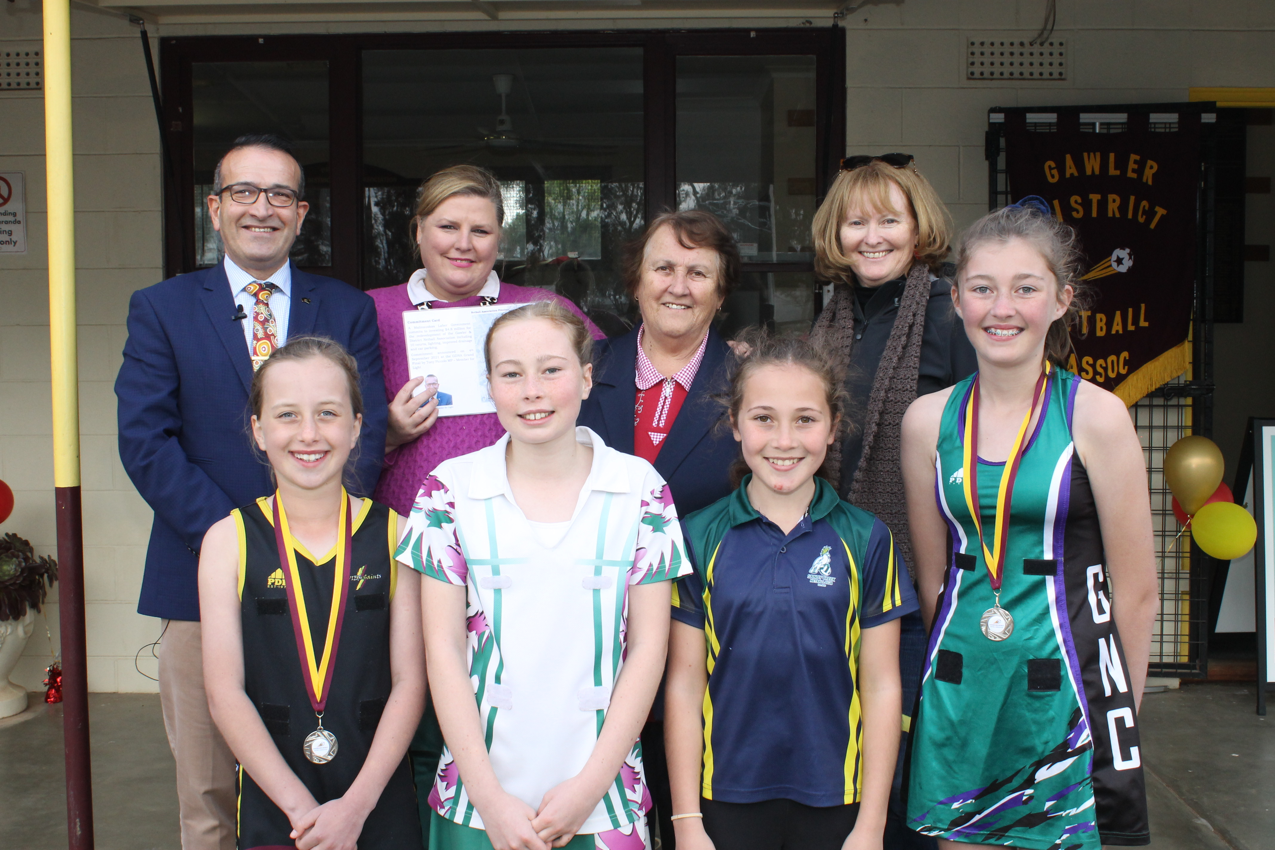 Photo: at the announcement were: (Back Row) Member for Light Tony Piccolo, GDNA President Kylie Forby, Patron Mrs Yolanda Cannizarro, and Gawler Mayor Karen Redman. (Front Row) (from left) Pippa Batki (Xavier Saints), Alice Costigan (Virginia), Ayla Beaucaris (Sandy Creek) and Haley Cornwall (Gumnuts).