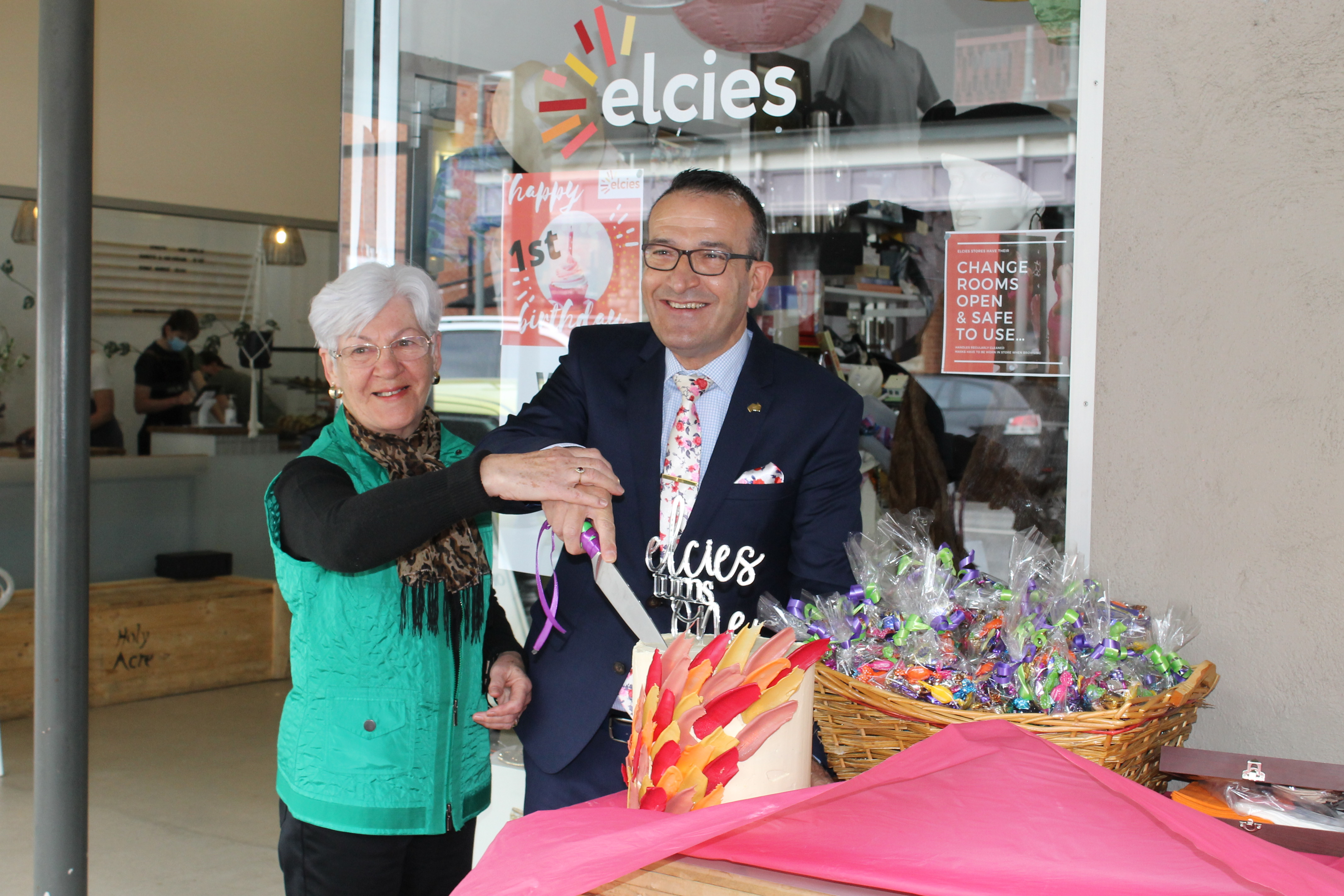 Tony Piccolo and Carol Poel cutting the cake to celebrate Elcies first birthday