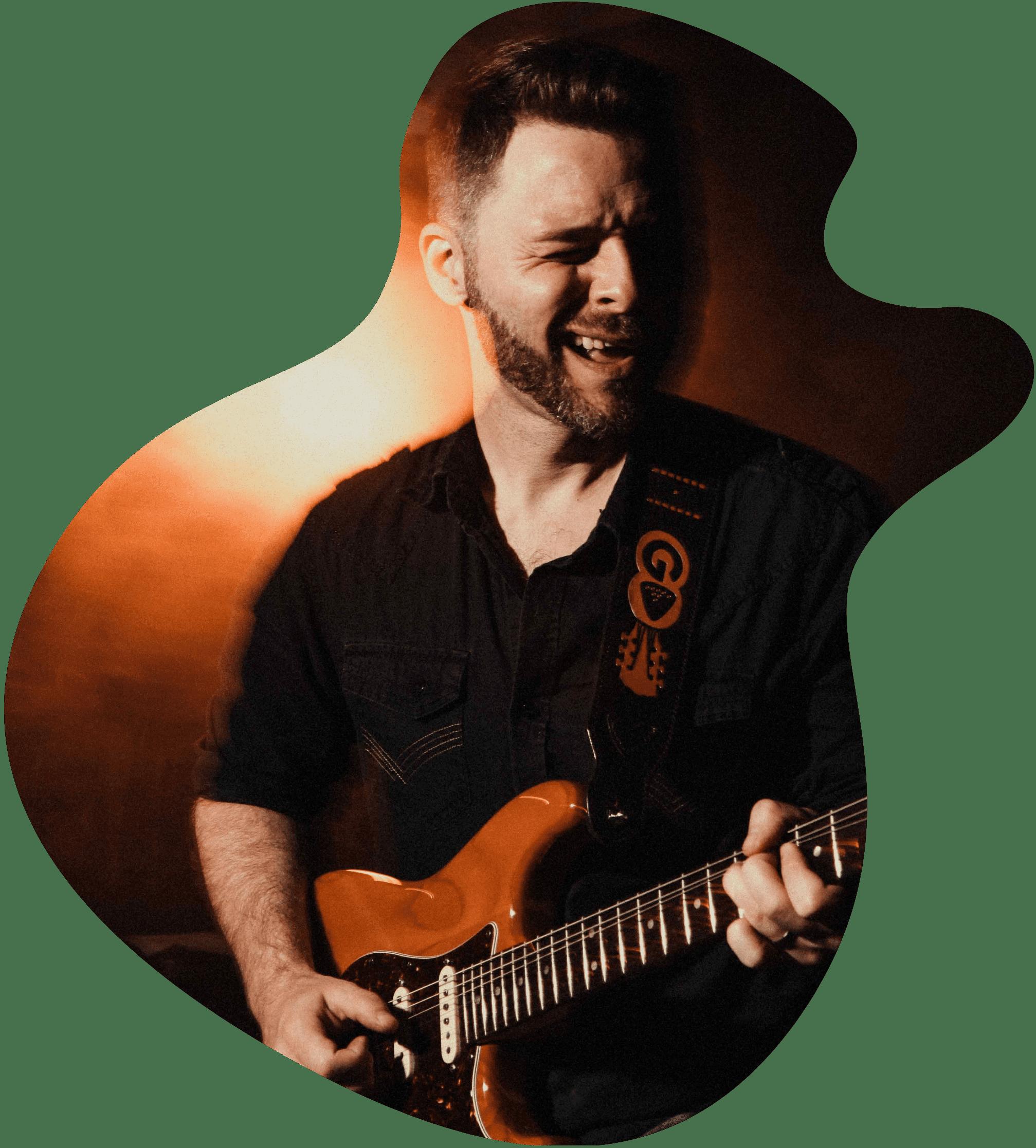 Francis O'Keefe jamming on his bass guitar