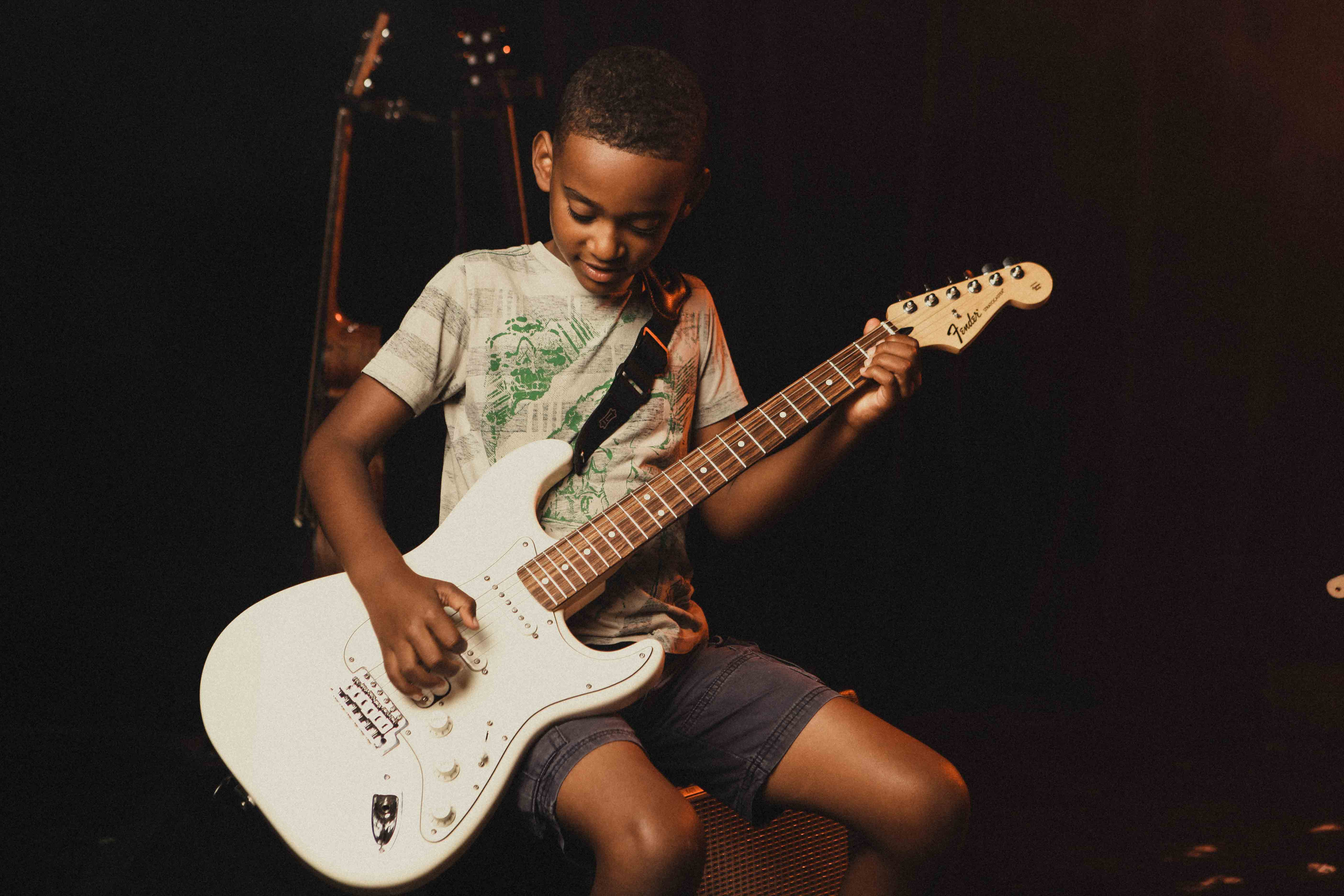Kid playing bass guitar