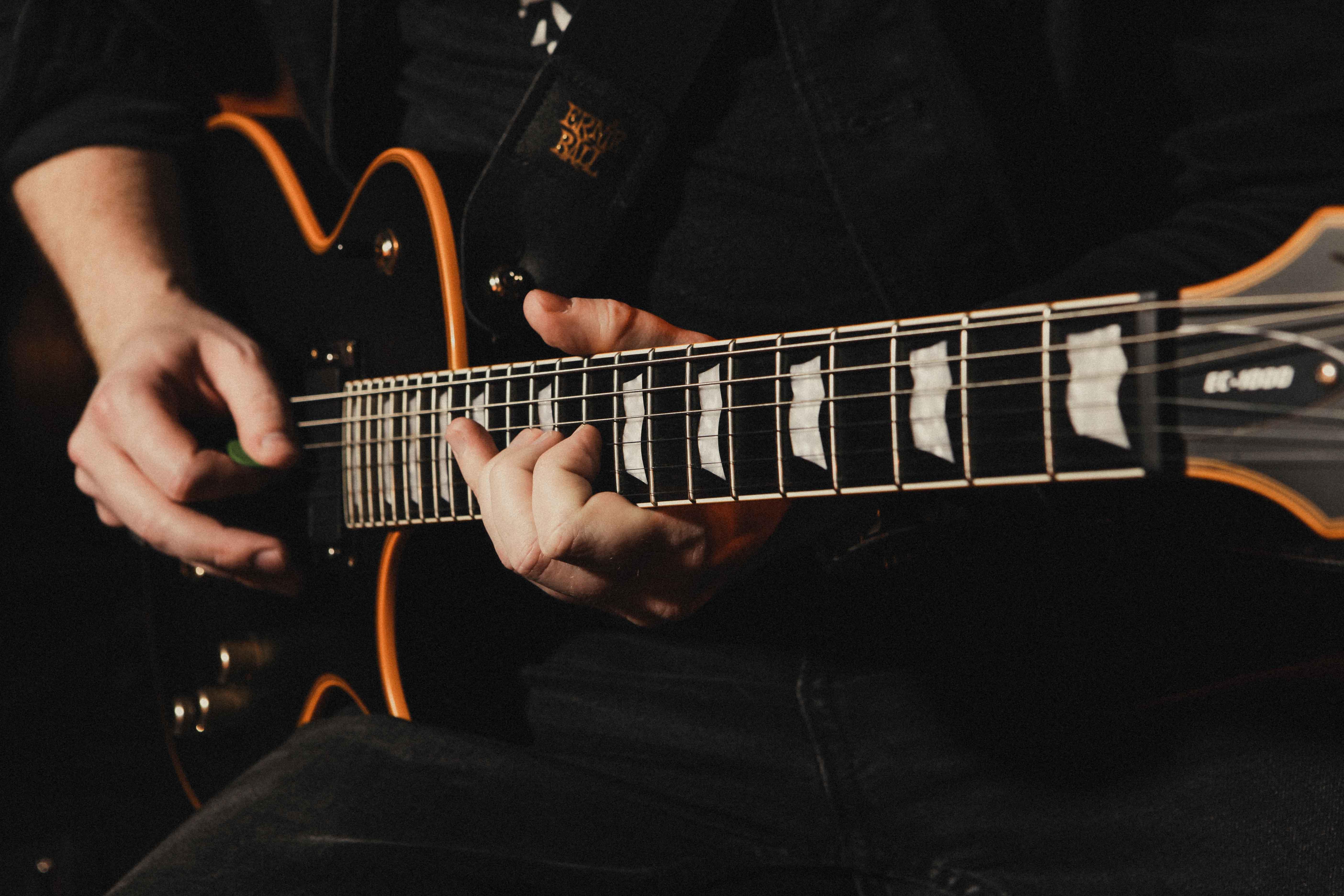 Closeup of someone playing bass guitar