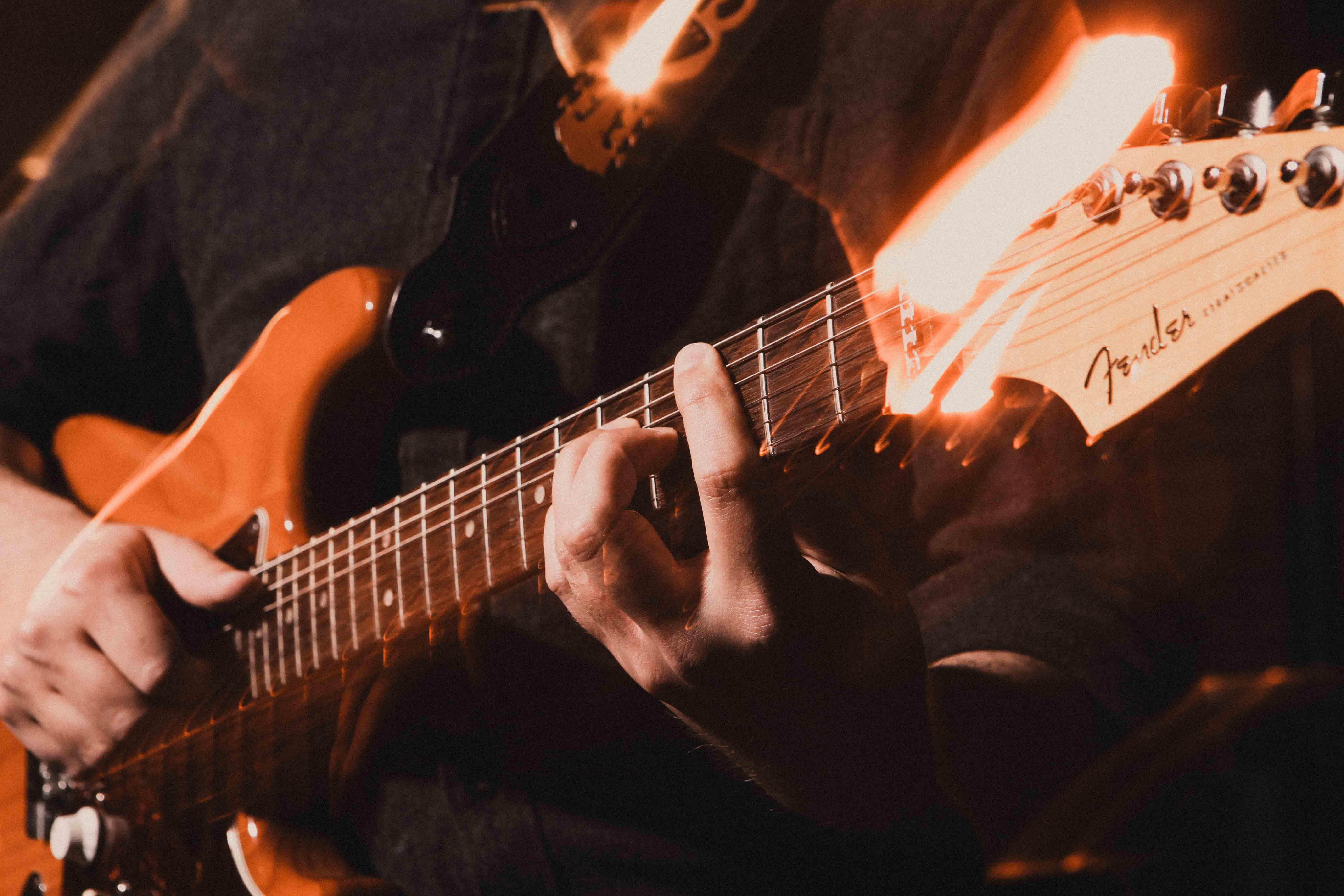 Fingers on a bass guitar