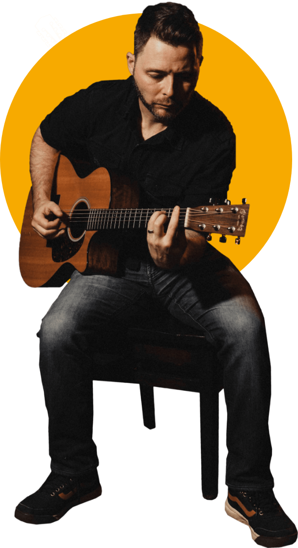 Francis O'Keefe playing an acoustic guitar