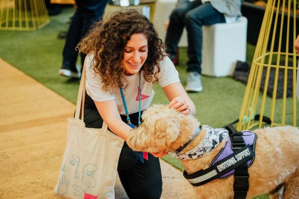 Woman petting a service dog
