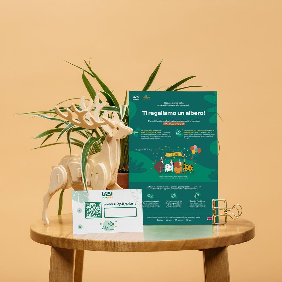 Foglio del servizio Up2You con comportamenti sostenibili e codice per piantare un albero