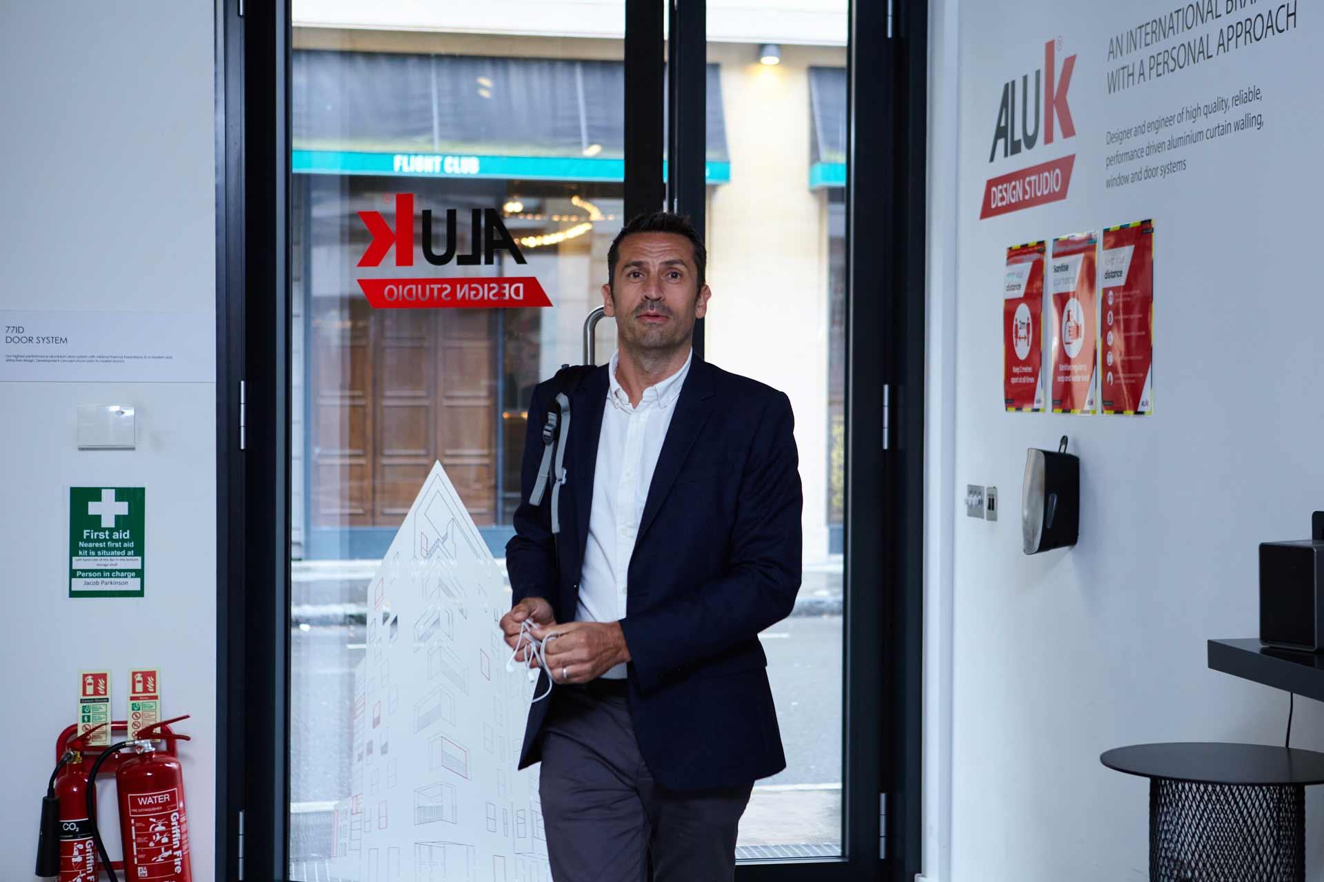 A professional entering the AluK Design Studio