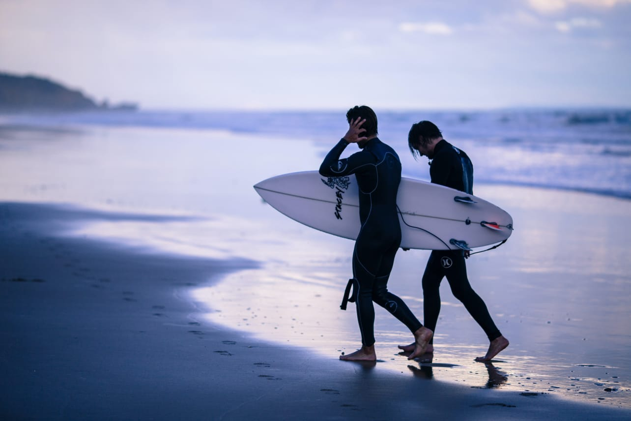 Two surfers on a beach