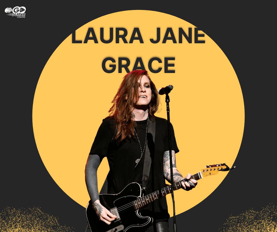 Laura Jane Grace playing a bass