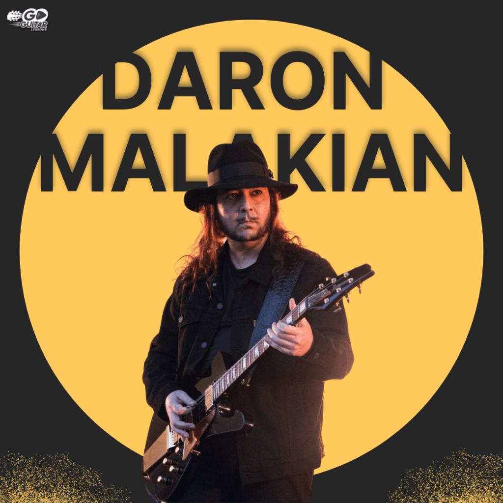Daron Malakian playing a bass