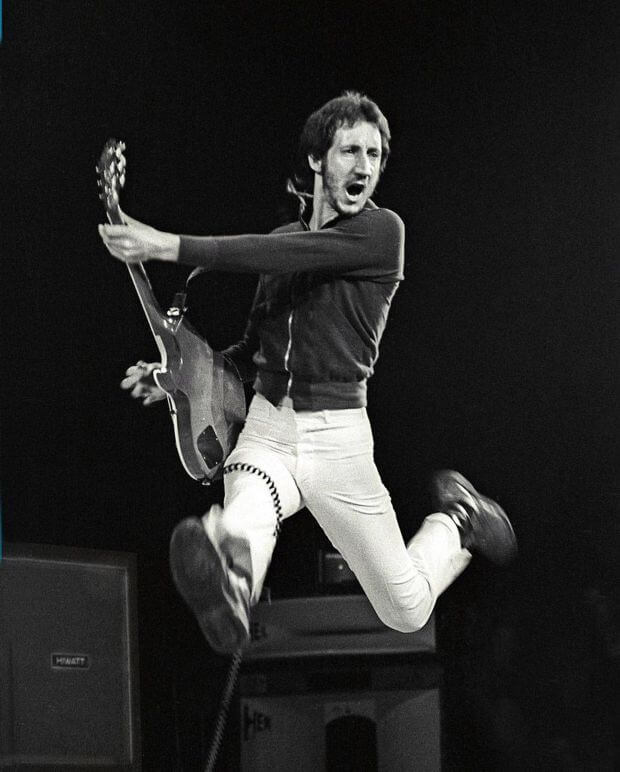 Pete Townshend jumping in the air with a bass