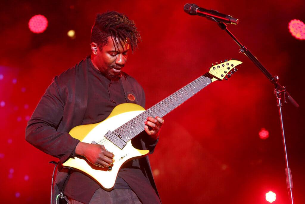 Tosin Abasi playing a bass