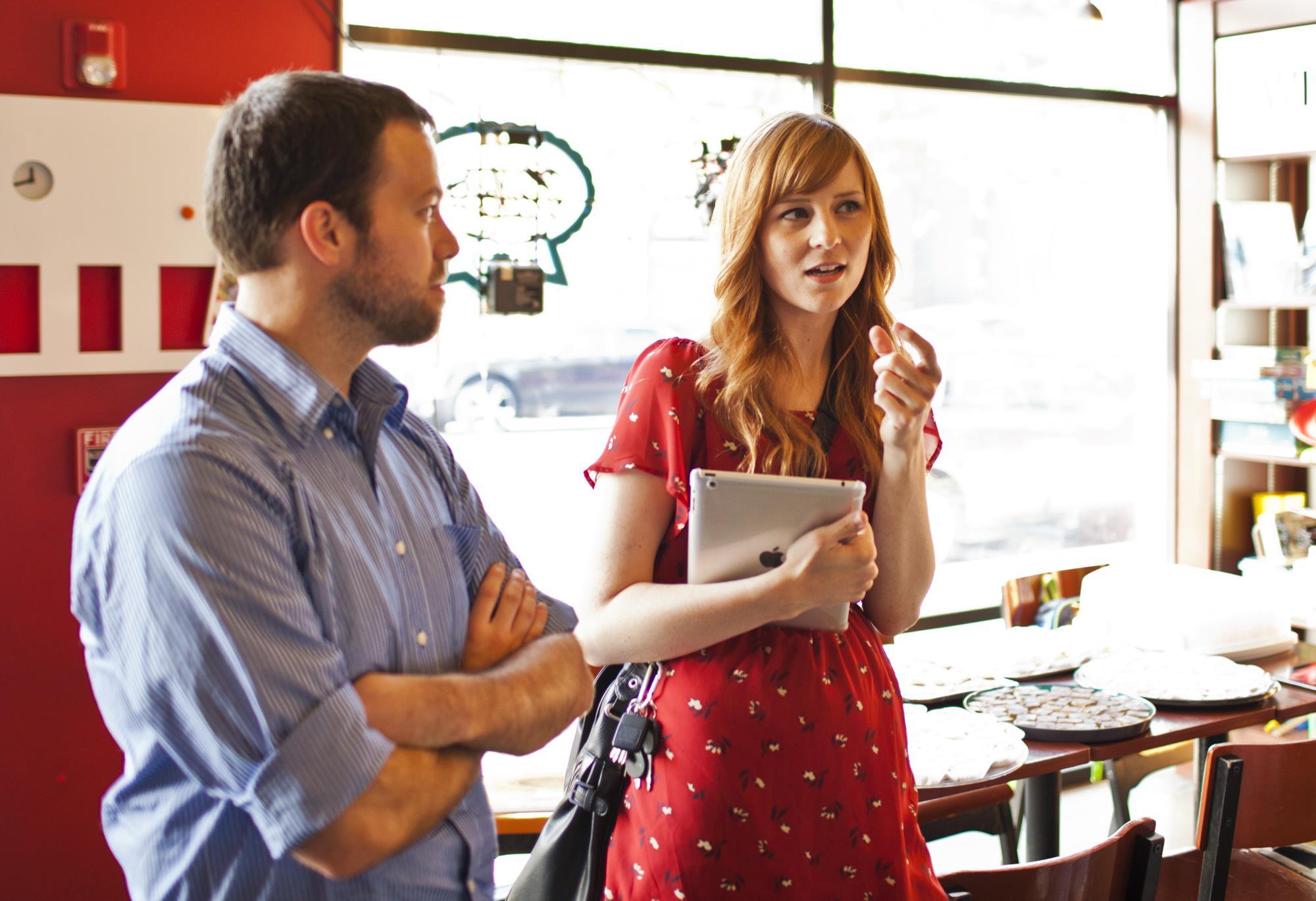 Amanda Morrow conversing with someone at a coffee shop.