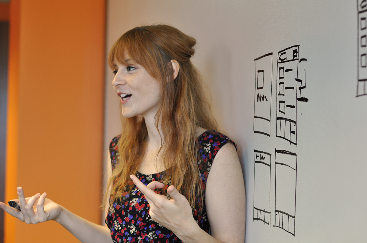Amanda Morrow teaching in front of a white board.