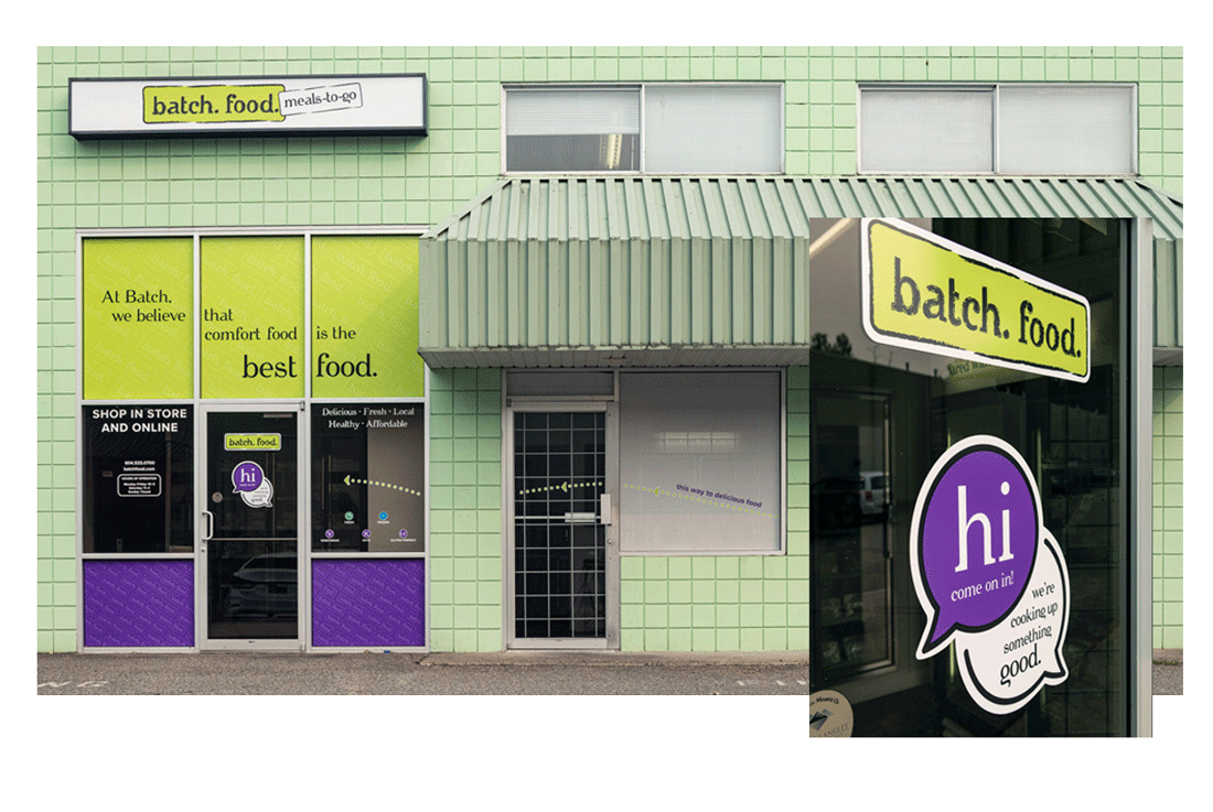 """Photo of the update exterior storefront. There are brand colours covering some windows, and details such as store hours and contact info are on display. On the front door a graphic says """"Hi, come on in! We're cooking up something good."""""""