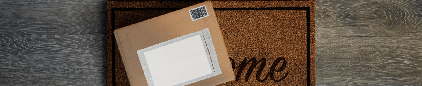 A brown box with a white label on a mat.