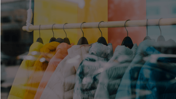 Clothes in hangers on a rack