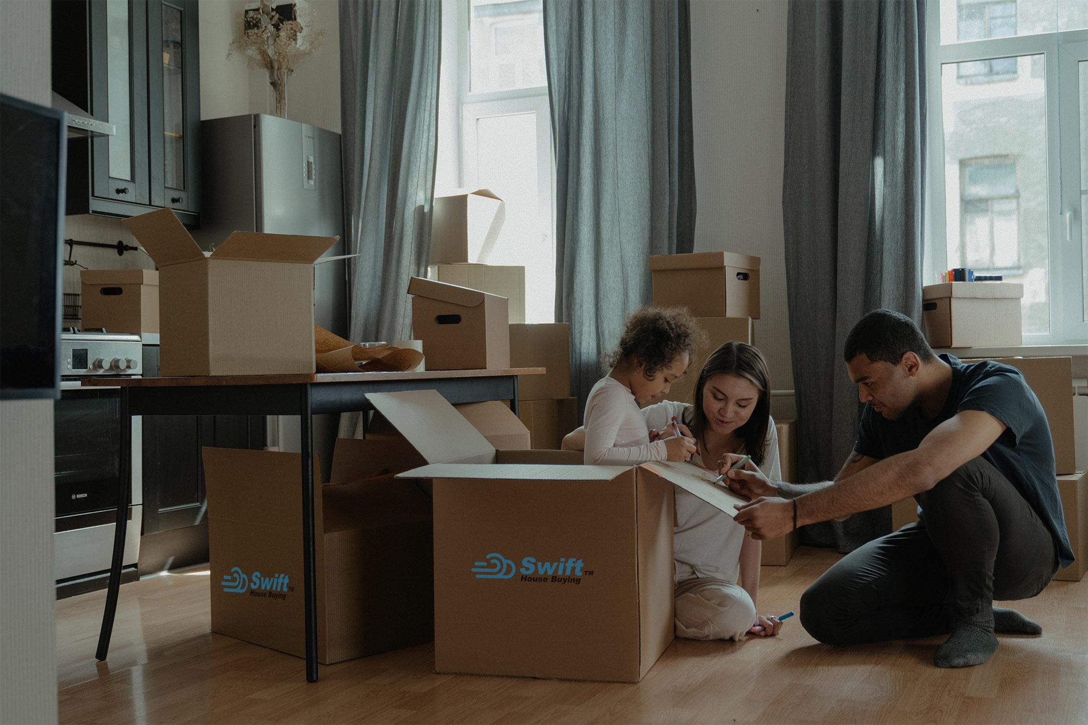 people sitting around swift real estate boxes smiling