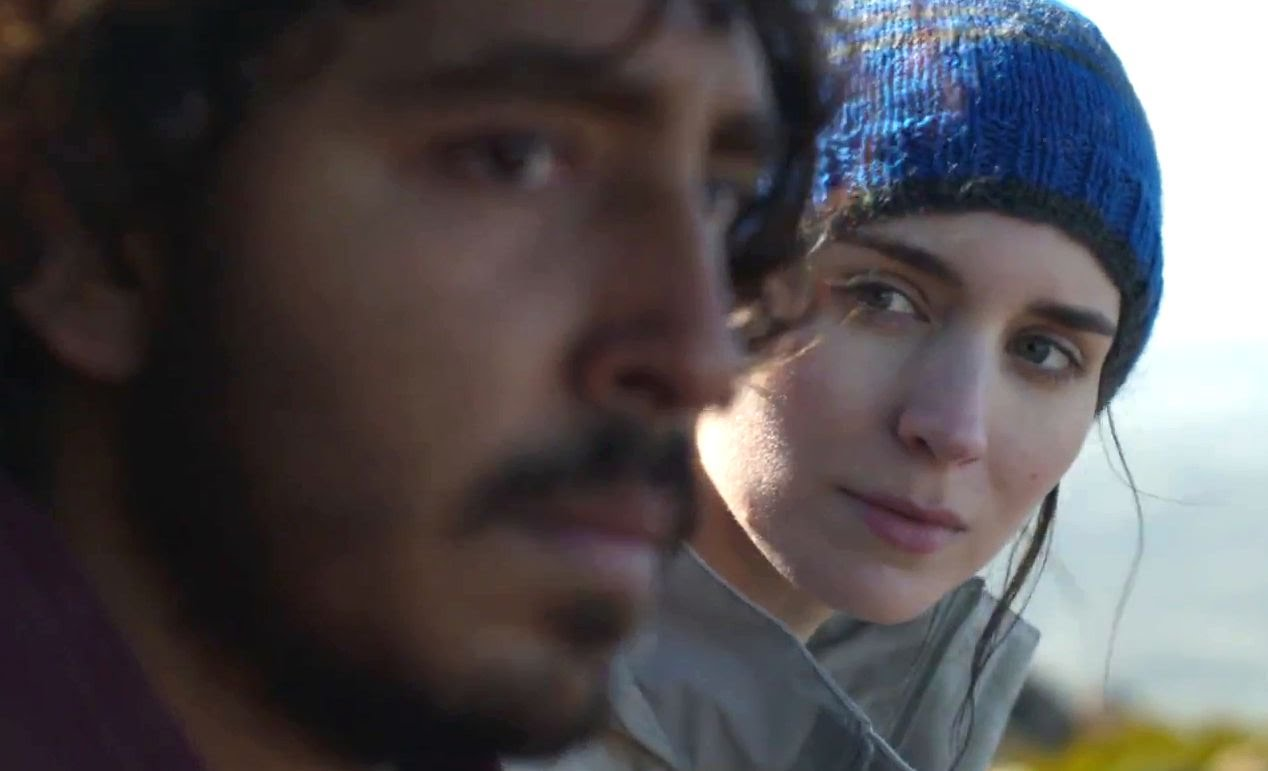 In Lion, Saroo Brinkley stares out into the distance as he realizes he must confront his journey to find his lost mother, alone, and without his lover, Lucy.