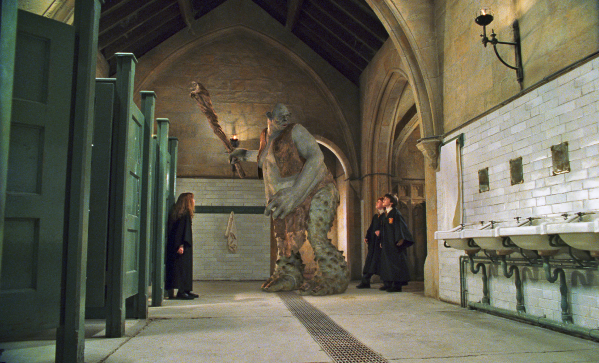 Harry, Ron, and Hermionie must confront their first major challenge, a troll in Harry Potter and The Philosopher's Stone