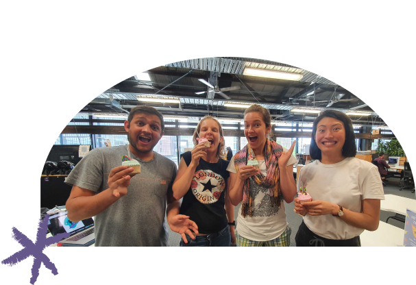 Photo of the Multitudes team celebrating with cupcakes.