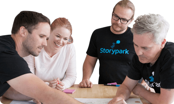The Storypark team brainstorms over a large canvas with post-it notes.