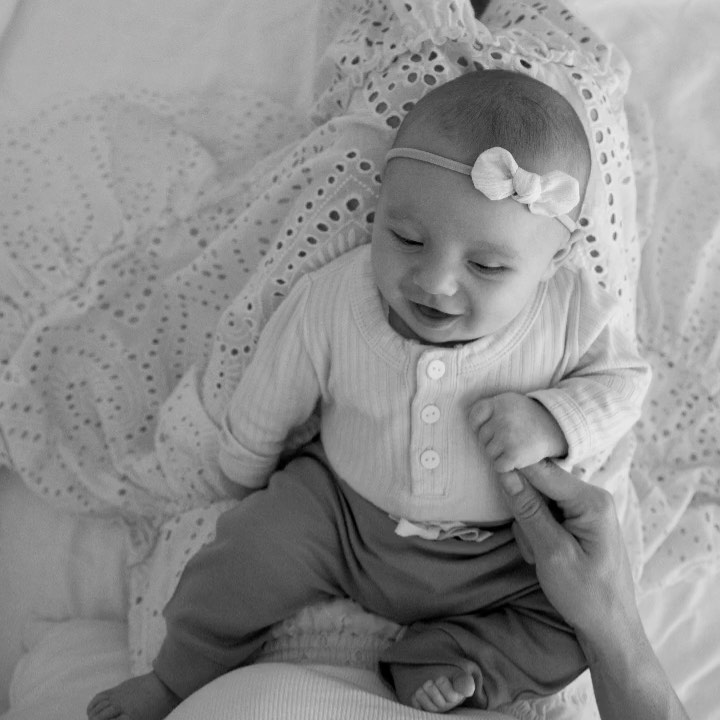 Black and white photo of baby smiling – one of hannah's favourite family memories