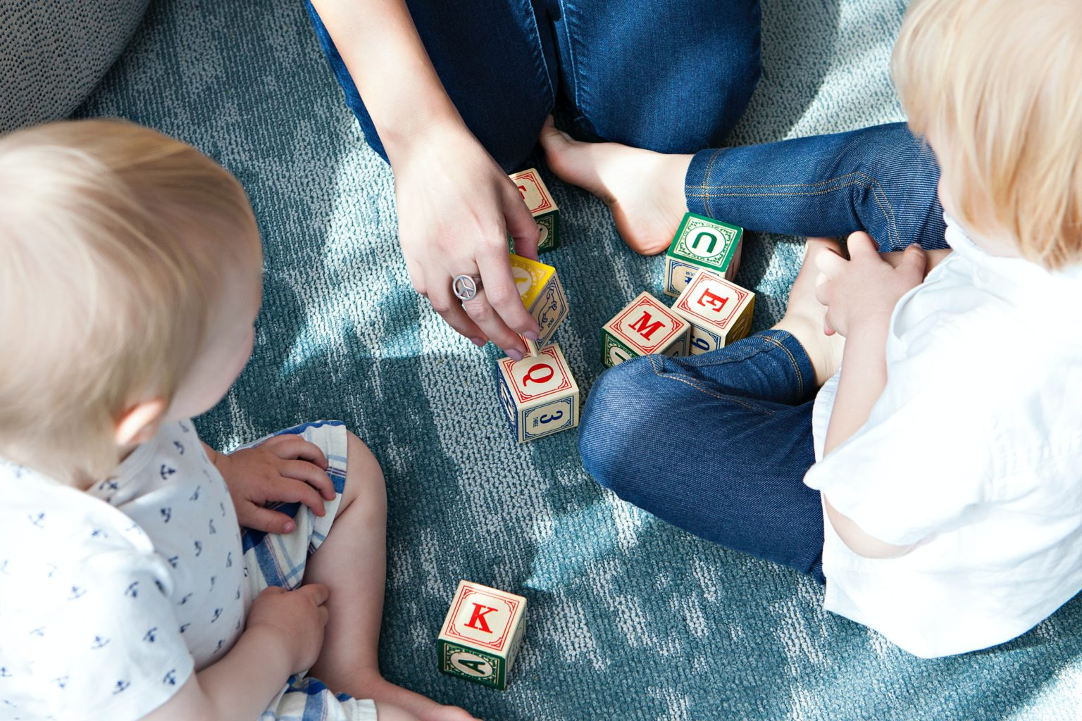 Toddler playing with letter blocks