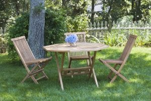 wooden lawn chairs arranged in a circle around a table