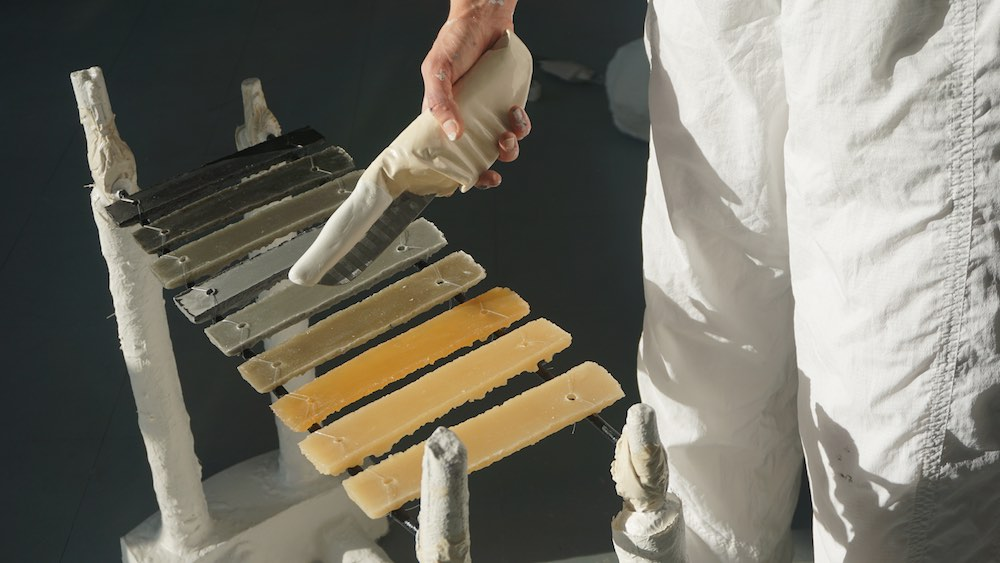 Mathilda Bennett-Greene's Teeth Tool about to strike her Xylostones sculpture