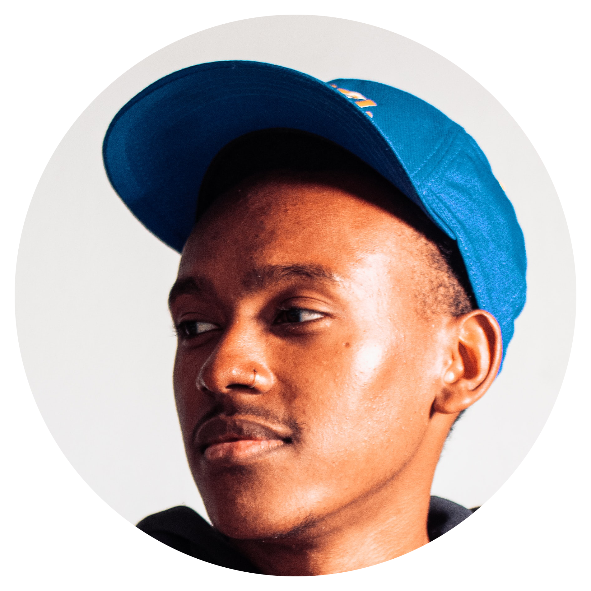Image of a young man with a blue baseball cap staring off to the left. This is a customer review image.