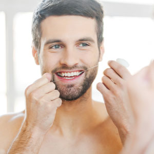 preventing gum disease with flossing
