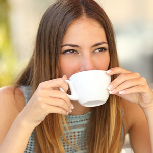 toothache jaw pain girl drinking from cup