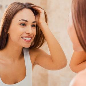 crooked teeth girl looking in mirror