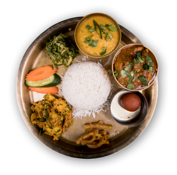 Traditional nepalese rice dish - thali served with curry and variety of side dished