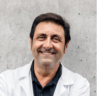 Photograph of a male doctor.