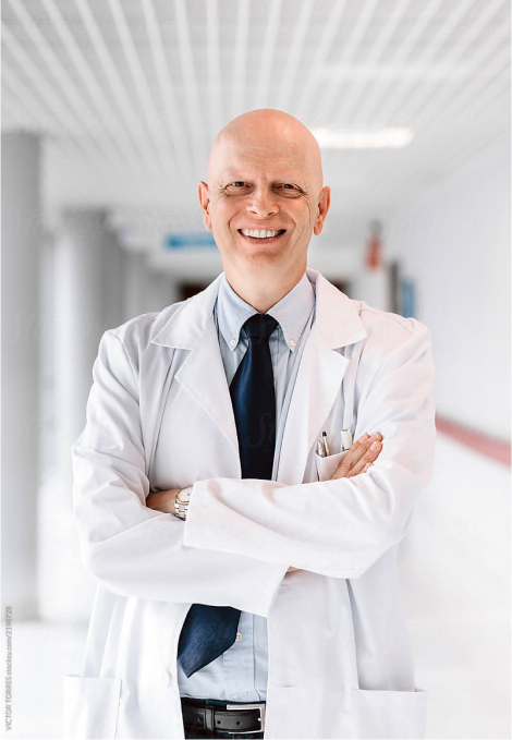 Photo of a doctor smiling.