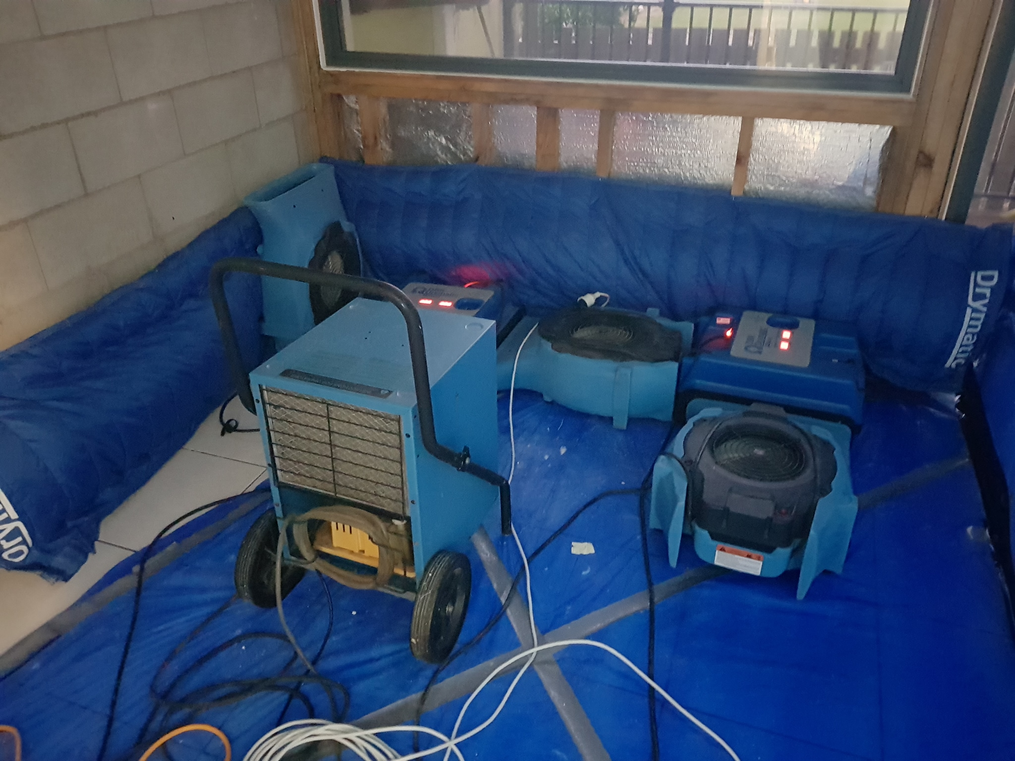 Drying equipment in use at a flooded property