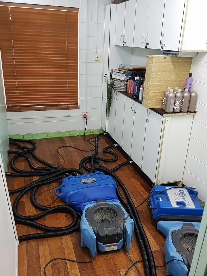 Drying equipment being used in a flooded hairdresser salon