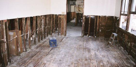 Half of gyprock removed from flooded walls in preparation for drying and cleaning