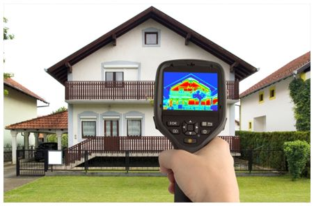 Thermal moisture reader being pointed at two storey house