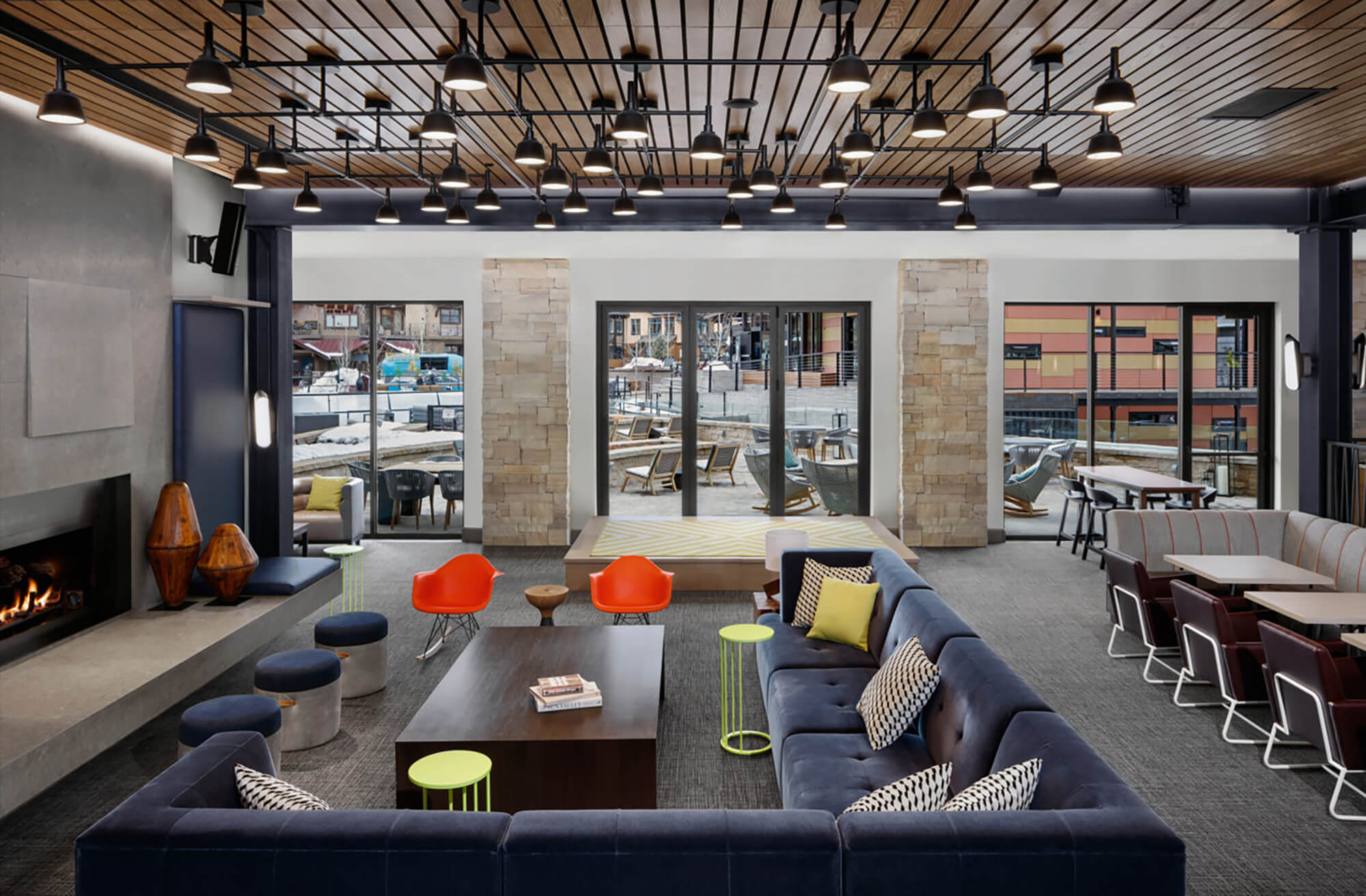 Open fire and lounge interior design at the Limelight Snowmass.