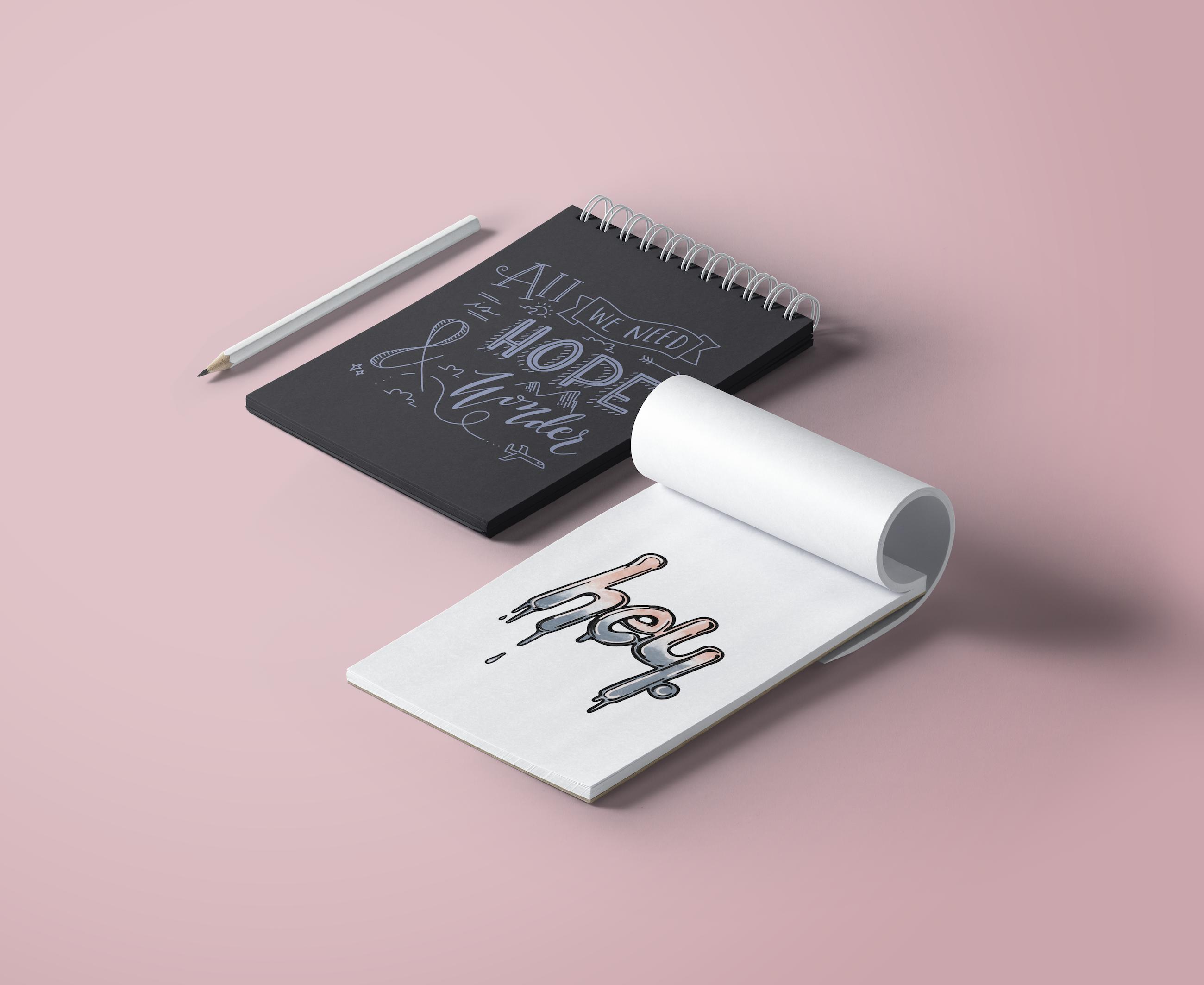 Mockup of lettering illustrations on notepads