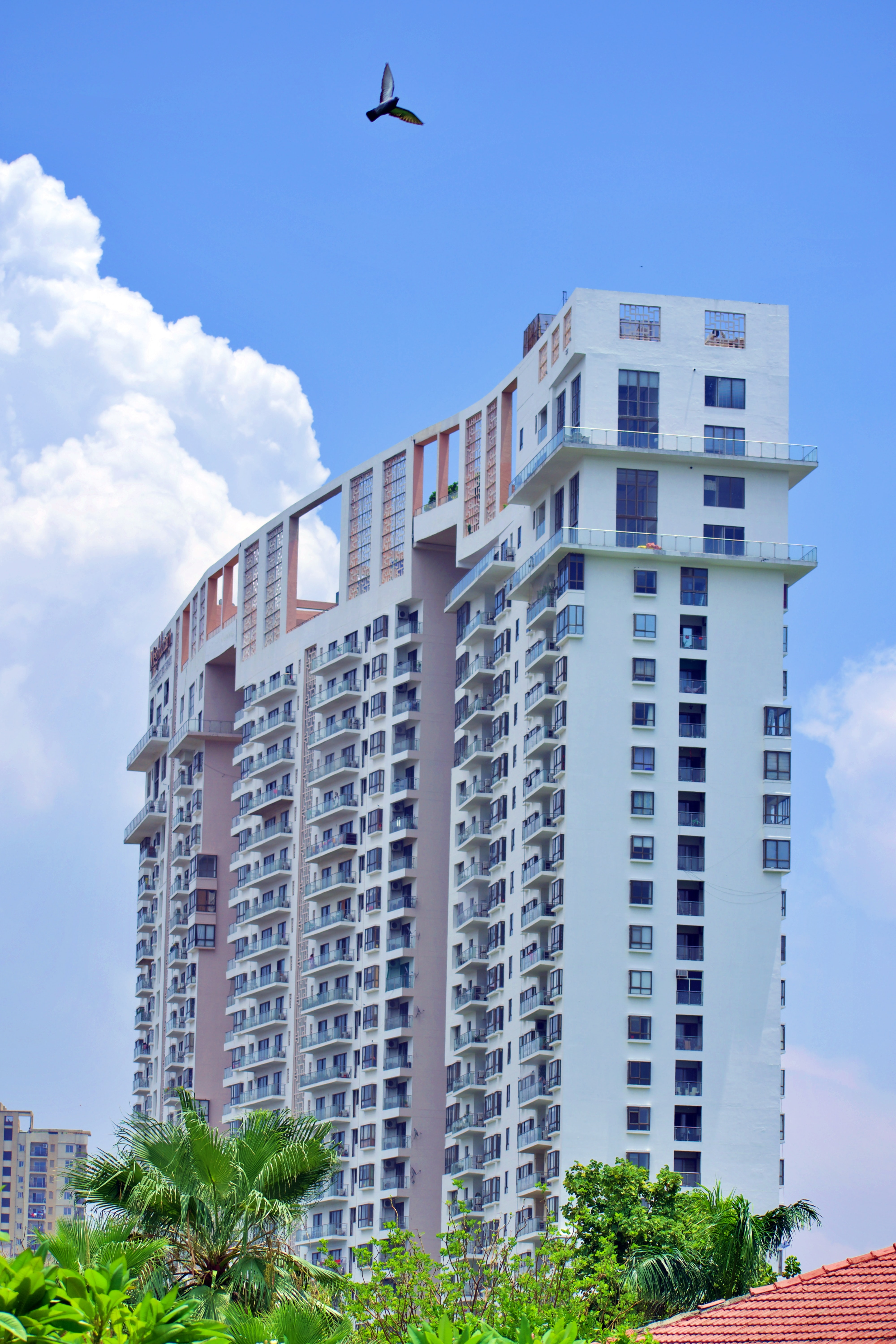 apartment building with blue skies - lease engine - multifamily apartment marketing