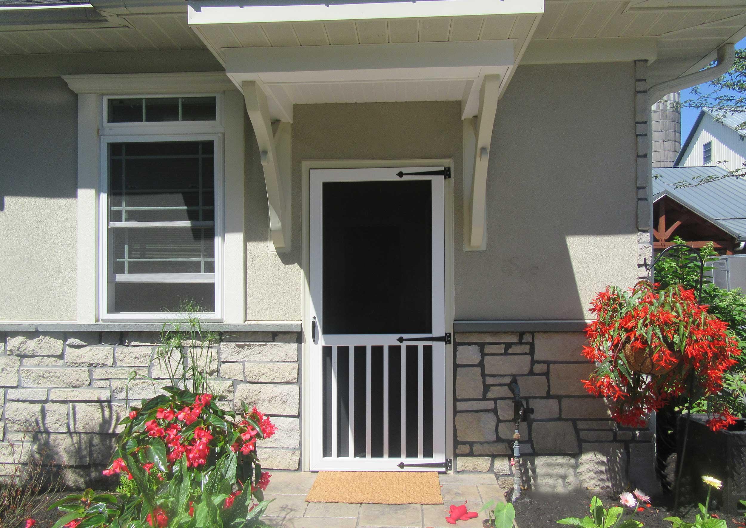 Vinyl Window Wells front of home with vinyl screen door